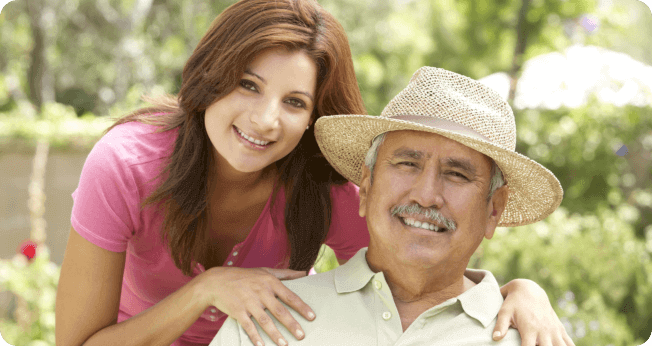 senior man with his daughter smiling